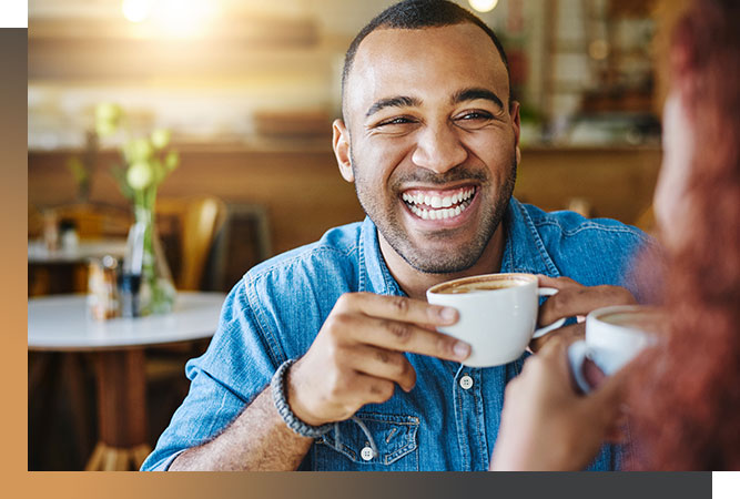 Young happy man drinking coffee